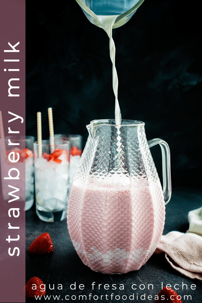 Milk being poured into a pitcher to make Strawberry Milk