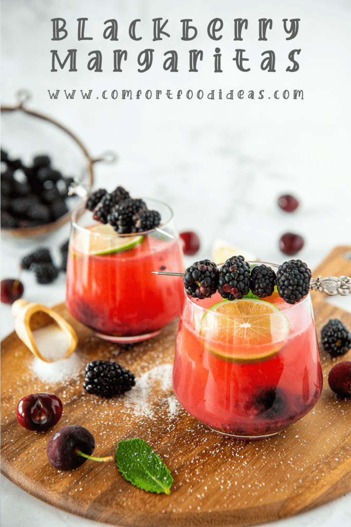 Pinterest Pin for Blackberry Margaritas shown on a wooden tray
