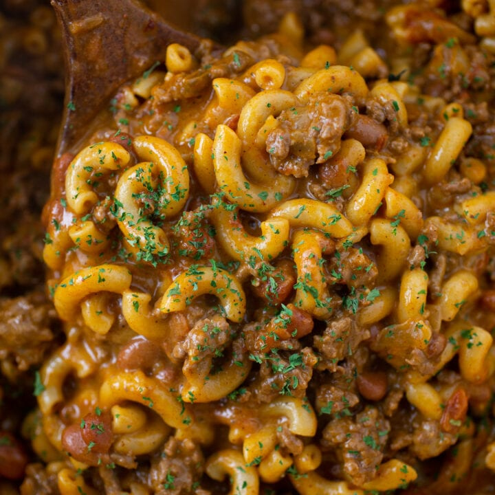 Close-up of Chili Mac and Cheese in a pot with a wooden spoon