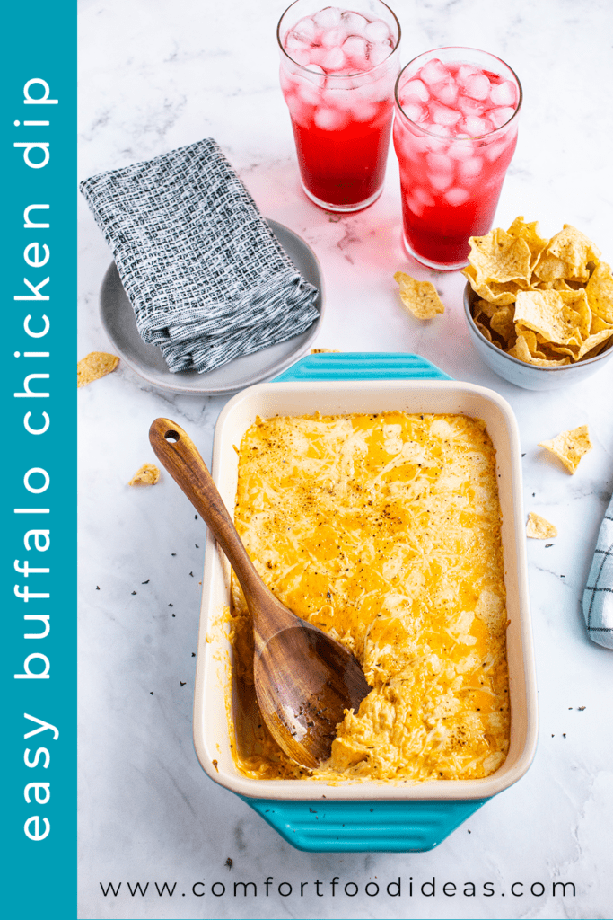 Pin for Easy Buffalo Chicken Dip in a casserole dish with a wooden spoon