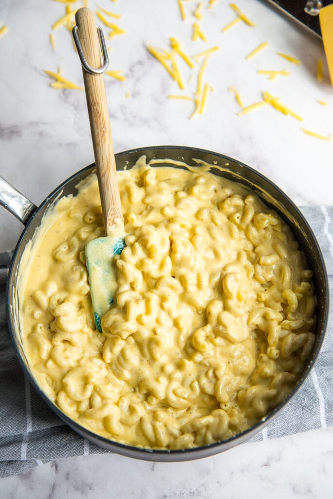 Skillet of creamy mac and cheese before baking