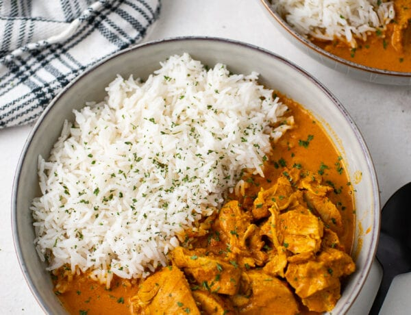 Bowl of butter chicken with white rice