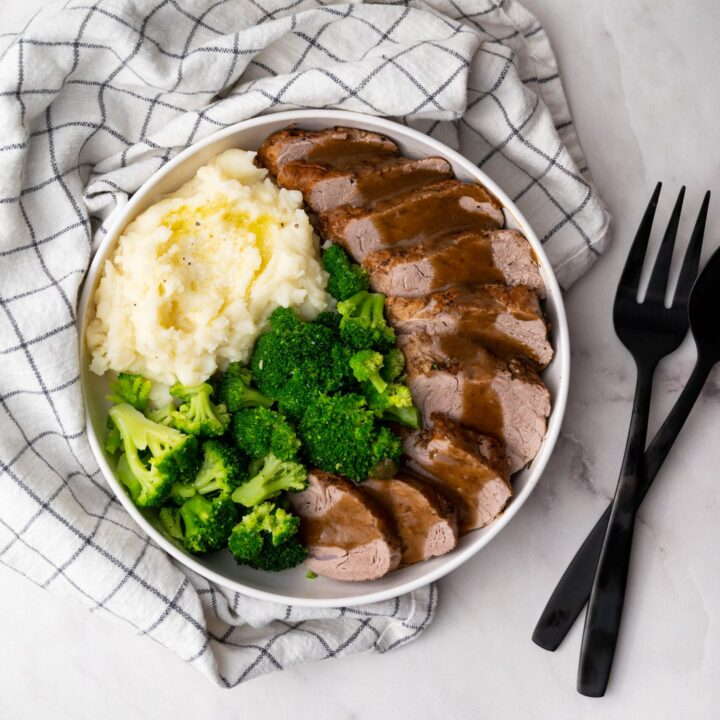 Apple Cider Pork Tenderloin served with steamed broccoli and mashed potatoes