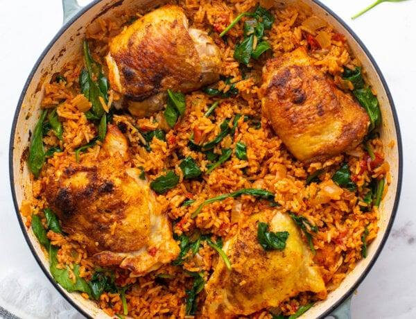 Pot of Chicken Paprika and Spanish Rice with Spinach in a pot